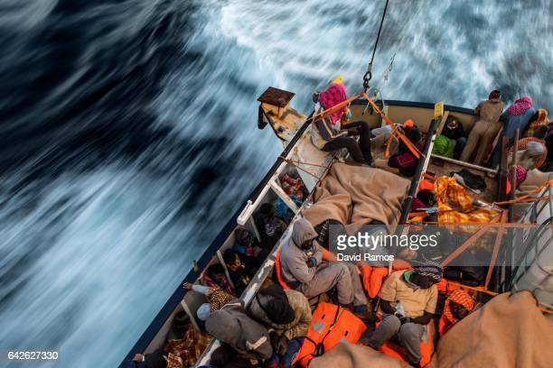 Refugees and migrants sleep on the deck of the Spanish NGO Proactiva Open Arms rescue vessel Golfo Azzurro after being rescued off Libyan coast north...