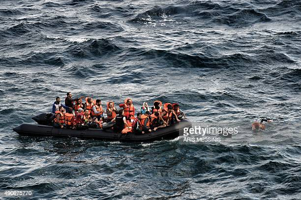 Refugees and migrants try to reach the Greek island of Lesbos after crossing the Aegean sea from Turkey on September 30 2015 Europe's migrant crisis...