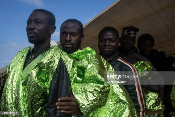 Refugees and migrants wait to disembark the Migrant Offshore Aid Station 'Phoenix' vessel on May 20 2017 in Trapani Italy The group of more than 300...
