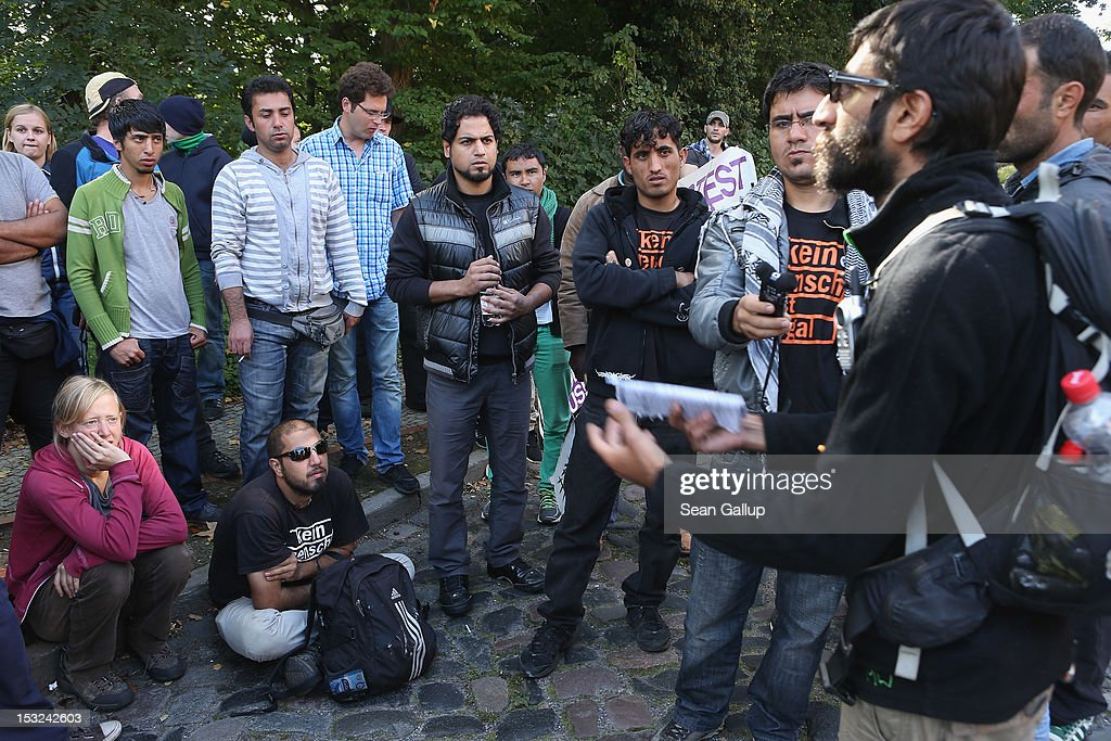 Refugees and supporters consult before continuing on their protest march across nearly 600km from Wuerzburg to Berlin on October 2, 2012 in Bad Belzig, Germany. Approximately 25 refugees from Iran, Iraq, Afghanistan, Turkey and other nations who are seeking political asylum are marching to protest the conditions under which they live in Germany. Asylum seekers in Germany are by law prohibited from working and their ability to travel is very restricted. The group expects to arrive in Berlin on October 6.
