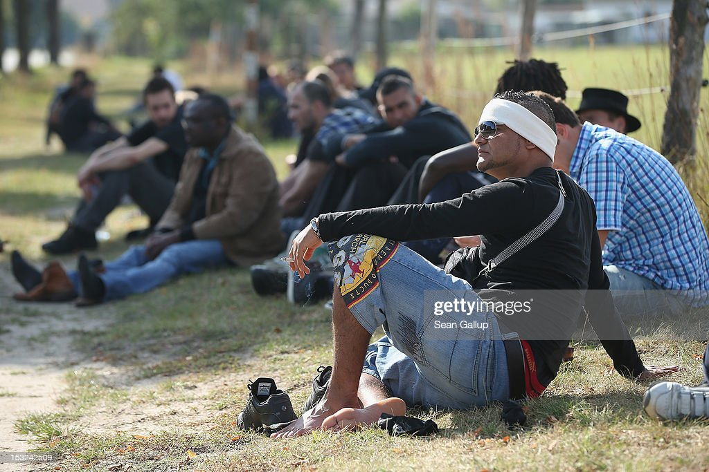 Refugees and supporters walk stop for a rest in the hamlet of Neschholz during their protest march across nearly 600km from Wuerzburg to Berlin on October 2, 2012 near Bad Belzig, Germany. Approximately 25 refugees who are seeking political asylum are marching to protest the conditions under which they live in Germany. Asylum seekers in Germany are by law prohibited from working and their ability to travel is very restricted. The group expects to arrive in Berlin on October 6.
