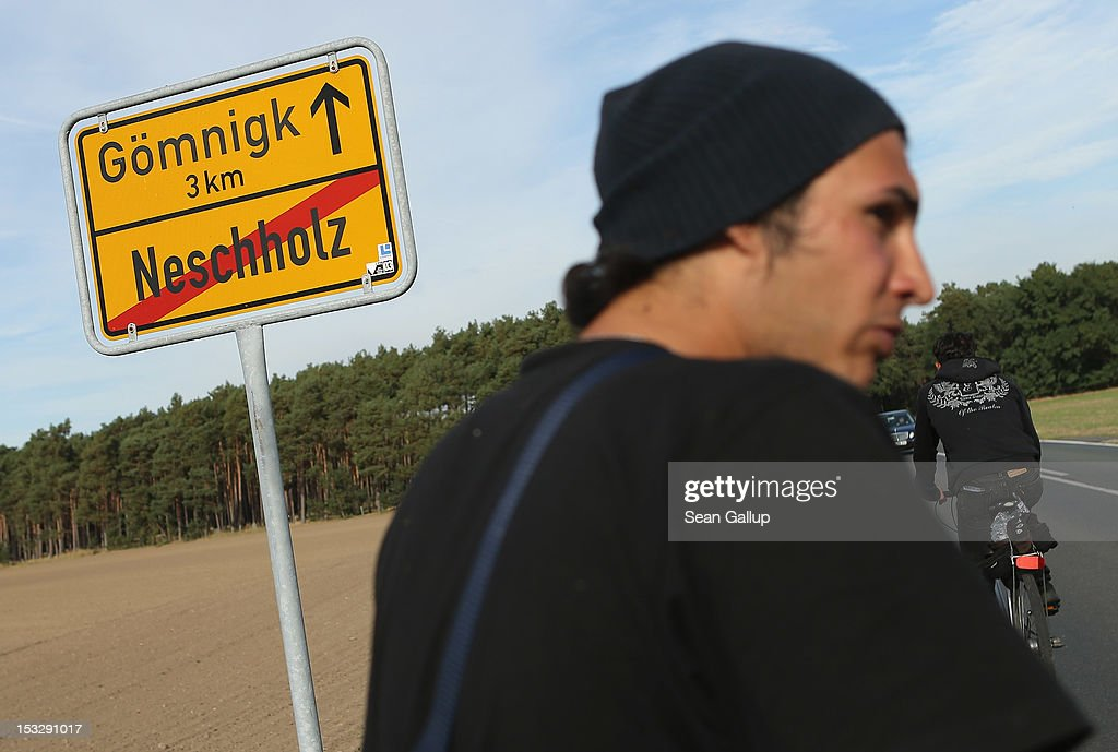 Refugees and supporters walk through the hamlet of Neschholz during their protest march across nearly 600km from Wuerzburg to Berlin on October 2, 2012 near Bad Belzig, Germany. Approximately 25 refugees from Iran, Iraq, Afghanistan, Turkey and other nations who are seeking political asylum are marching to protest the conditions under which they live in Germany. Asylum seekers in Germany are by law prohibited from working and their ability to travel is very restricted. The group expects to arrive in Berlin on October 6.