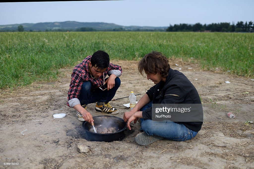 Refugees are cooking a meal near a field , located next to Idomeni refugee camp on May 1'st, 2016. Humanitarian conditions in the camp are deteriorating as many thousands of migrants are still located in the makeshift refugee camp, located at the Greece-Macedonia border, waiting for the border to re-open.
