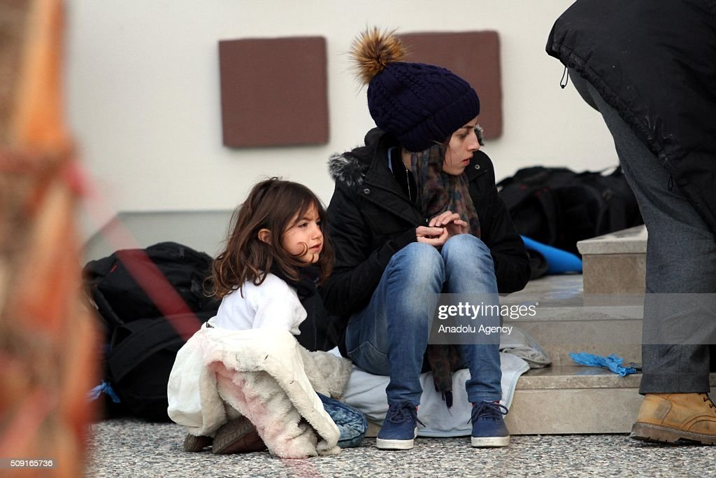 Refugees are seen as they wait outside the Fethiye District Police Department Directorate after Turkey 122 refugees were captured in the Aegean Sea on February 9, 2016. Total of 122 refugees were captured by Turkish coast guards while they were illegally trying to reach Greece's Rhodes island through the Aegean Sea.