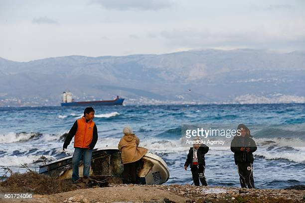 Refugees are seen at Ciftlikkoy neighborhood in Cesme district of Izmir as they wait to continue their journey due to weather conditions on December...