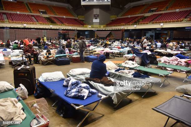 Refugees are seen at the Roberto Clemente Coliseum refuge in San Juan Puerto Rico on September 19 prior the arrival of Hurricane Maria Maria headed...