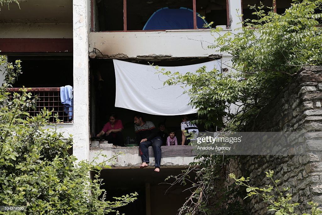 Refugees are seen in an abandoned house as they try to continue their daily life near Idomeni refugee camp in Greece on May 25, 2016.