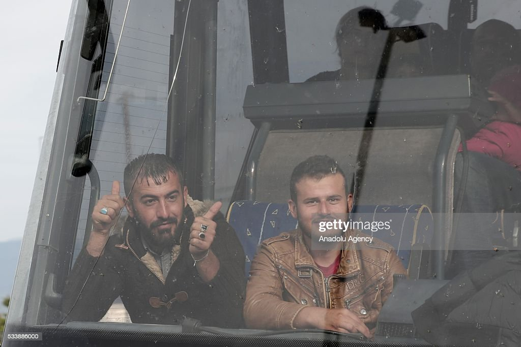Refugees are seen on a bus during a police operation that began to evacuate the makeshift refugee camp at the Greek-Macedonian border near the northern Greek village of Idomeni on May 24, 2016.