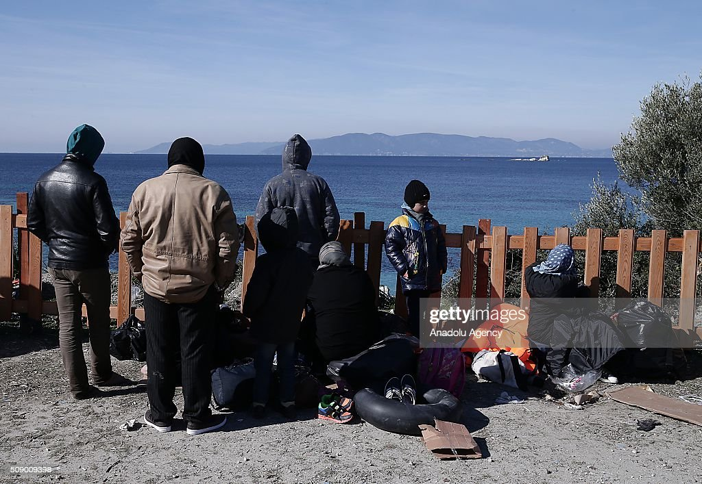 Refugees are seen on the coast as Turkish gendarmerie captures around 700 refugees, who were trying to reach Lesbos Island of Greece, in operations conducted at 3 different bays, namely Pissa, Bahceli and Candarli, in Dikili district of Izmir, Turkey on February 8, 2016.
