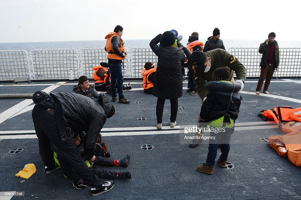 Refugees are seen on Turkish Coast Guard ship TCSG Umut (Hope) after 54 refugees and asylum seekers were captured in the Aegean Sea, in shores of Canakkale province of Turkey, as they attempted to reach the nearby Greek islands. on February 09, 2016.