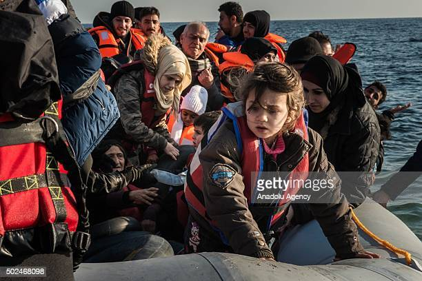 Refugees are seen upon their arrival on Mytilene of Lesbos Island Greece after crossing the Aegean sea from Turkey on December 25 2015