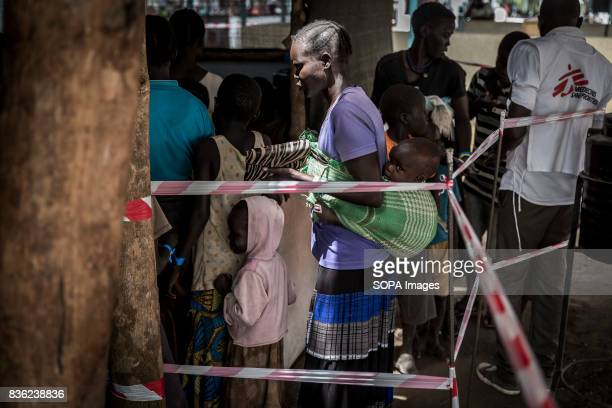 Refugees are seen waiting in line to be seen by a MSF doctor The number of South Sudanese refugees who crossed its border has reached one million...
