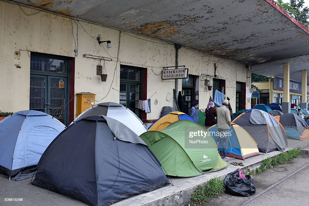 Refugees are standing near tents on the dock in the old Idomeni train station on May 1'st, 2016 in Idomeni refugee camp. Humanitarian conditions in the camp are deteriorating as many thousands of migrants are still located in the makeshift refugee camp, located at the Greece-Macedonia border, waiting for the border to re-open.