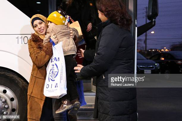 TORONTO ON DECEMBER 15 Refugees arrive by bus from the airport to the Travelodge where they will spend the night in the airport strip More than...