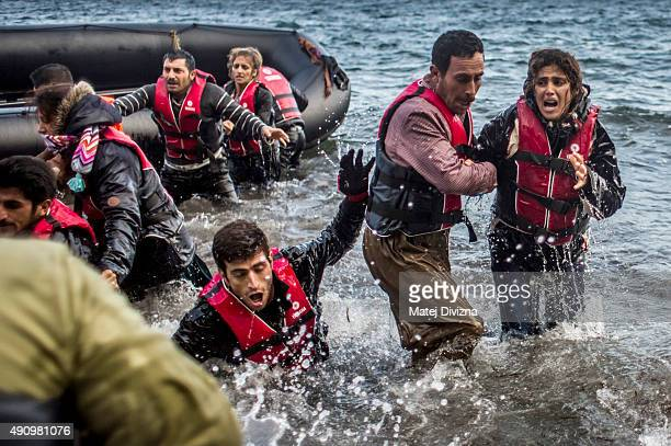 Refugees arrive on the shores of the Greek island of Lesbos after crossing the Aegean sea from Turkey on an inflatable boat on October 2 2015 near...