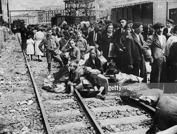 Refugees at the railway station in Bilbao during the Spanish Civil War June 1937 The refugees have returned to the city after its capture by Franco's...