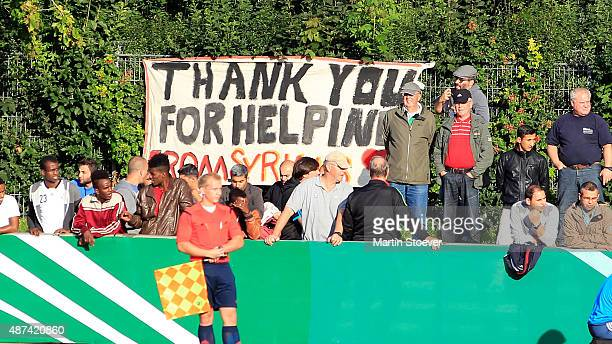 Refugees attend the match between U17 Germany v U17 Italy at Weserstadion 'Platz 11' on September 9 2015 in Bremen Germany