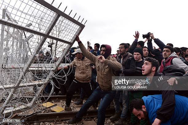 Refugees break into the GreekMacedonian borders during their protest demanding the opening of the borders near the village of Idomeni on February 29...