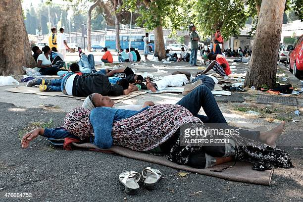 Refugees camp in the square in front of the Rome's Tiburtina station on June 11 2015 Known as 'the forest' it is home to migrants many of whom are...
