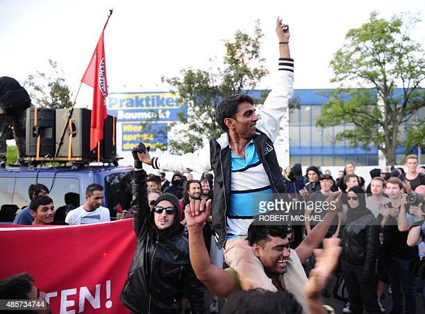 Refugees celebrate with leftist sympathizers at a shelter for asylum seekers on August 29 2015 in Heidenau eastern Germany Heidenau a town of around...