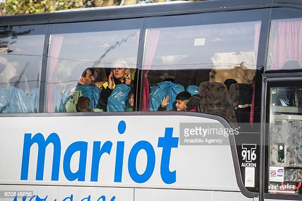 Refugees children look out the window of the bus leaving the center 'Jules Ferry' in Calais on November 3 2016 Over 350 women and Their children...