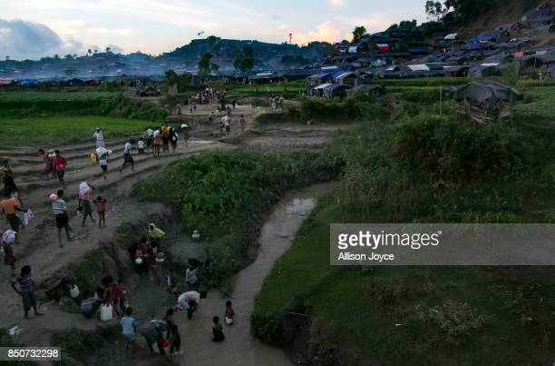 COX'S BAZAR BANGLADESH SEPTEMBER 21 Refugees collect water for drinking bathing and washing in the Unchiprang Rohingya refugee camp on September 21...