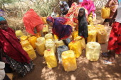 Refugees collect water on the outskirts of the Ifo refugee camp which makes up part of the giant Dadaab refugee settlement on July 20 2011 in Dadaab...
