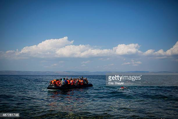 Refugees come ashore near the village of Skala Sikamineas on September 8 2015 in Lesbos Greece More than 230000 people have landed on Greek shores...