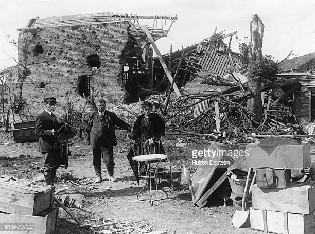 Refugees examine the ruins of their homes after intense fighting between German and Allied forces in their village of VillersBretonneux