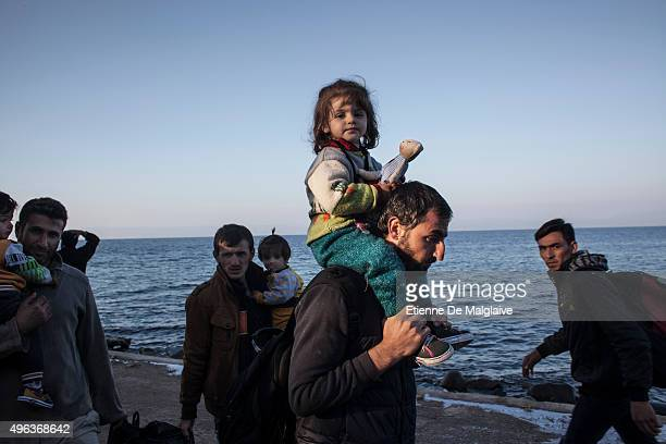 Refugees from Afghanistan and Syria arrive in boats on the shores of Lesbos on November 5 2015 near Skala Sikaminias Greece Lesbos the Greek vacation...