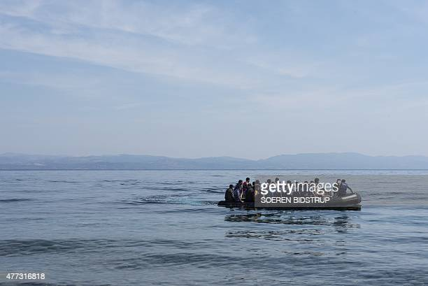 Refugees from Afghanistan arrive in a boat on the shores of Lesbos near Skala Skamnias Greece on June 2 2015 Lesbos the Greek vacation island in the...