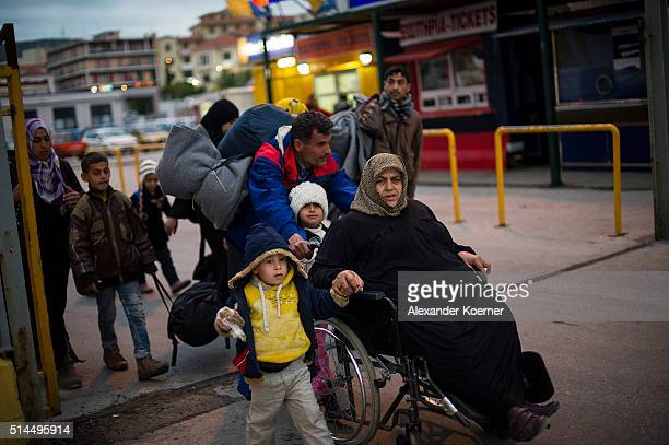 Refugees from Afghanistan make their way to the Port of Mytelene to board a ferry which will bring 500 refugees to Athens on March 9 2016 in Mytelene...