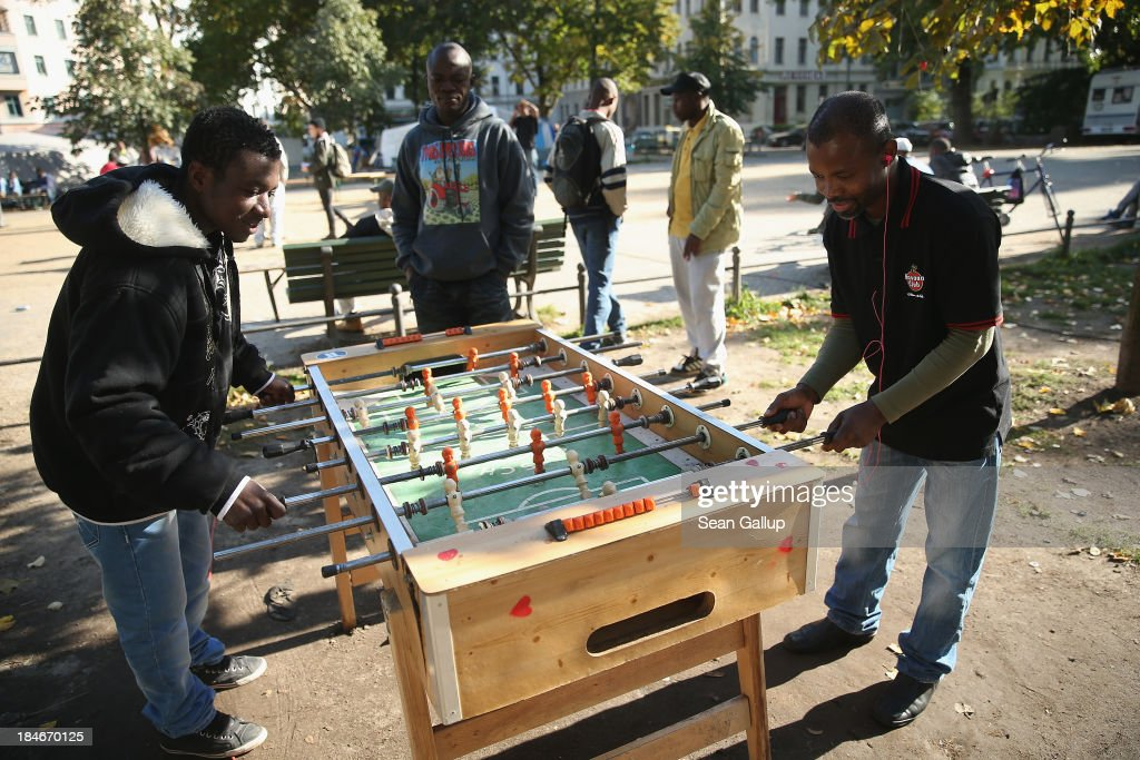 Refugees from Africa, most of whom made their way to Europe via Lampedusa, play table soccer at the makeshift tent camp where approximately 100 refugees are living at Oranienplatz in Kreuzberg district on October 14, 2013 in Berlin, Germany. Berlin authorities have tolerated the camp at Oranienplatz and have promised to move the refugees to proper housing ahead of the coming winter.