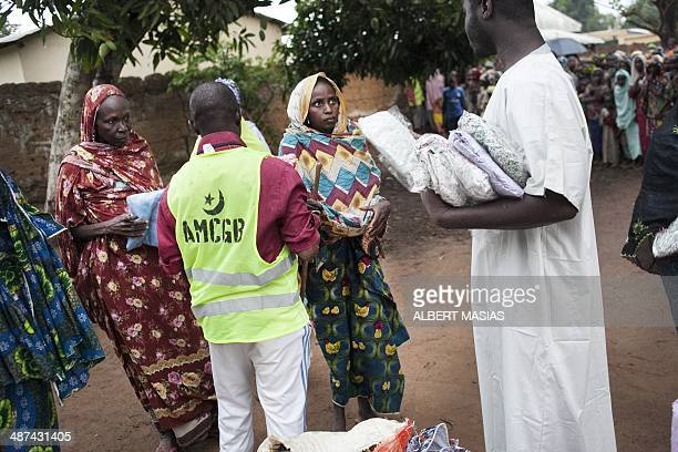 Refugees from Central Africa are distributed foods and clothes delivered by humanitarian associations in the Cameroonian Garoua Boulaï border town on...