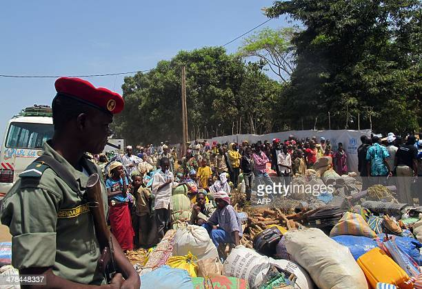 Refugees from Central Africa wait for a food distribution at an UNHCR refugee camp in the eastern Cameroonian city of GarouaBoulai not far from the...
