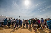 Refugees from eastern Ukraine queue to get food in a refugee camp near the Russian city of Donets'k Rostov region about 15 kilometers from the...