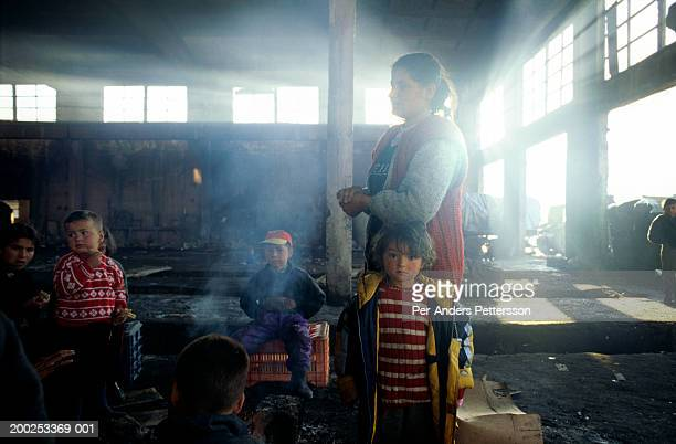 Refugees from Kosovo stay in a deserted factory in Kukes, Albania