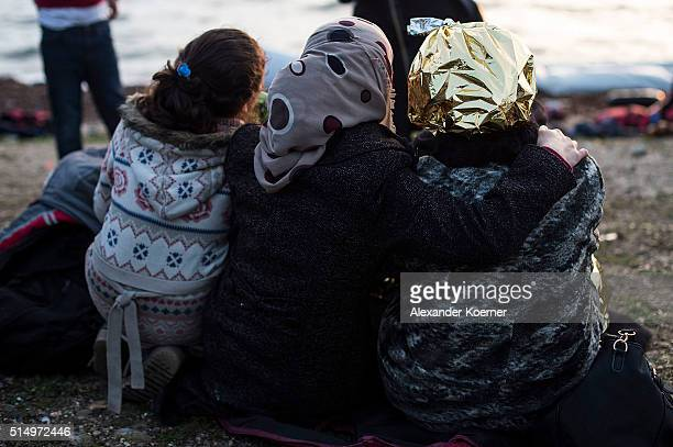 Refugees from mainly Afghanistan and Syria are seen shortly after arriving on an inflatable boat with other refugees crossing the sea from Turkey to...