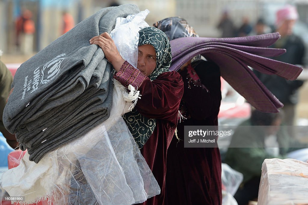ZA'ATARI JORDAN JANUARY 30 Refugees from Syria collect blankets and supplies from the UNHCR as they arrive at the Za'atari refugee camp on January 30...