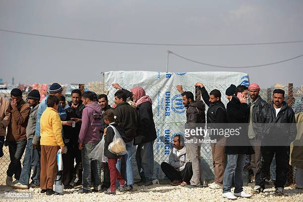 ZA'ATARI JORDAN JANUARY 30 Refugees from Syria collect food and supplies from the UNHCR as they arrive at the Za'atari refugee camp on January 30...