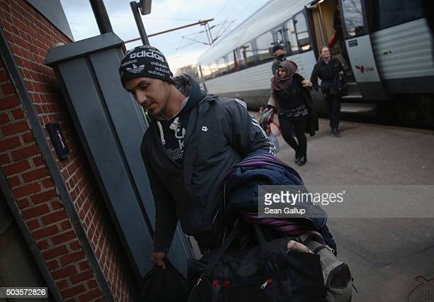 Refugees from Syria disembark from a train after police found them while checking the identity papers of passengers on a train arriving from Germany...