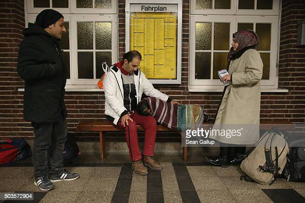 Refugees from Syria hoping to receive asylum in Denmark wait for a train in a train station near the Danish border on January 6 2016 in Flensburg...