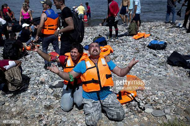 Refugees from Syria pray after arriving on the shores of the Greek island of Lesbos aboard an inflatable dinghy across the Aegean Sea from from...