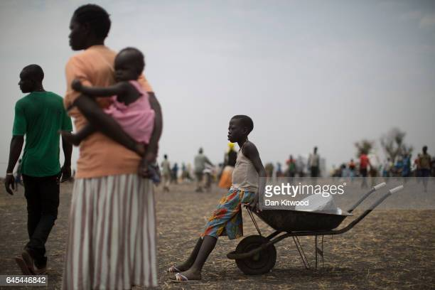 Refugees gather at a settlement on February 25 2017 in Palorinya Uganda The continued flow of refugees from South Sudan is putting pressure on the...
