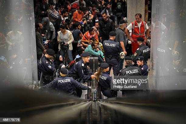 Refugees gather on a platform at the railway station on September 14 2015 in Salzburg Austria German authorities announced they are temporarily...