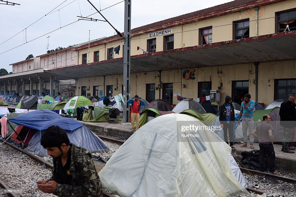 Refugees gather on the dock of old Idomeni train station, as tents are located on the dock and on the rails on May 1'st, 2016 in Idomeni refugee camp. Humanitarian conditions in the camp are deteriorating as many thousands of migrants are still located in the makeshift refugee camp, located at the Greece-Macedonia border, waiting for the border to re-open.