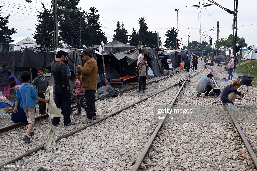 Refugees gather on the rails in the of old Idomeni train station near tents located on the rails on May 1'st, 2016 in Idomeni refugee camp. Humanitarian conditions in the camp are deteriorating as many thousands of migrants are still located in the makeshift refugee camp, located at the Greece-Macedonia border, waiting for the border to re-open.