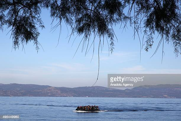 Refugees hoping to cross into Europe arrive at the shore of Lesbos Island Greece on November 03 2015