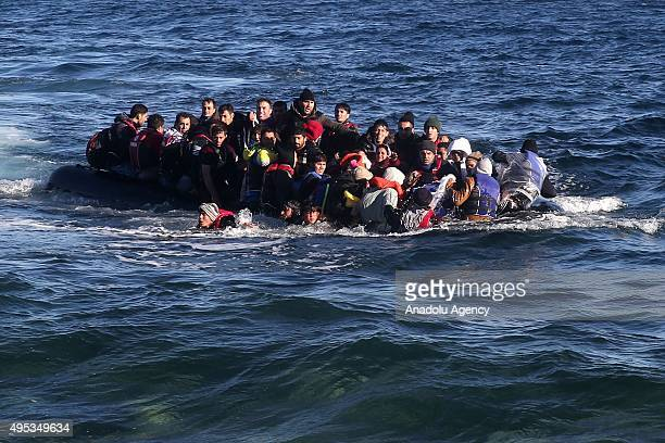 Refugees hoping to cross into Europe arrive on the shore of Lesbos Island Greece on November 02 2015