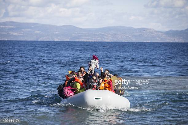 Refugees hoping to cross into Europe arrive on the shore of Lesbos Island Greece after crossing the Aegean sea from Turkey on November 29 2015